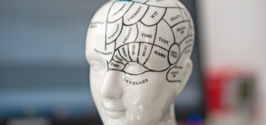 Parts of the human brain and the functions for each part. In the background there is a monitor and keyboard. Concept for brain functions and activity