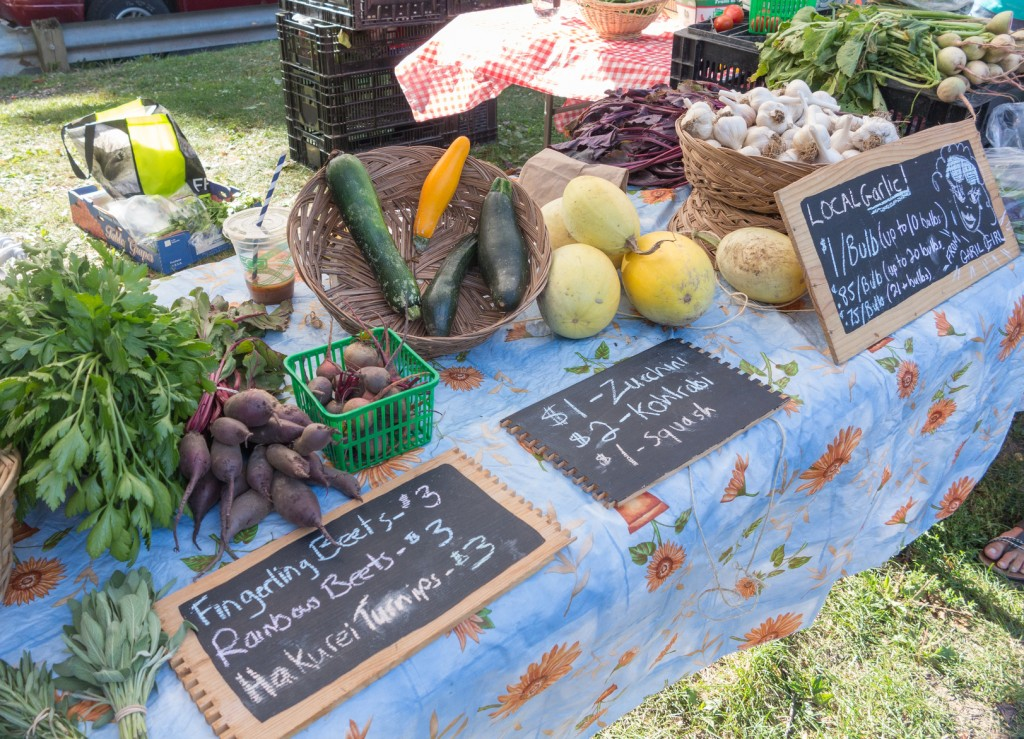 Display of local produce at outdoor farmers' market