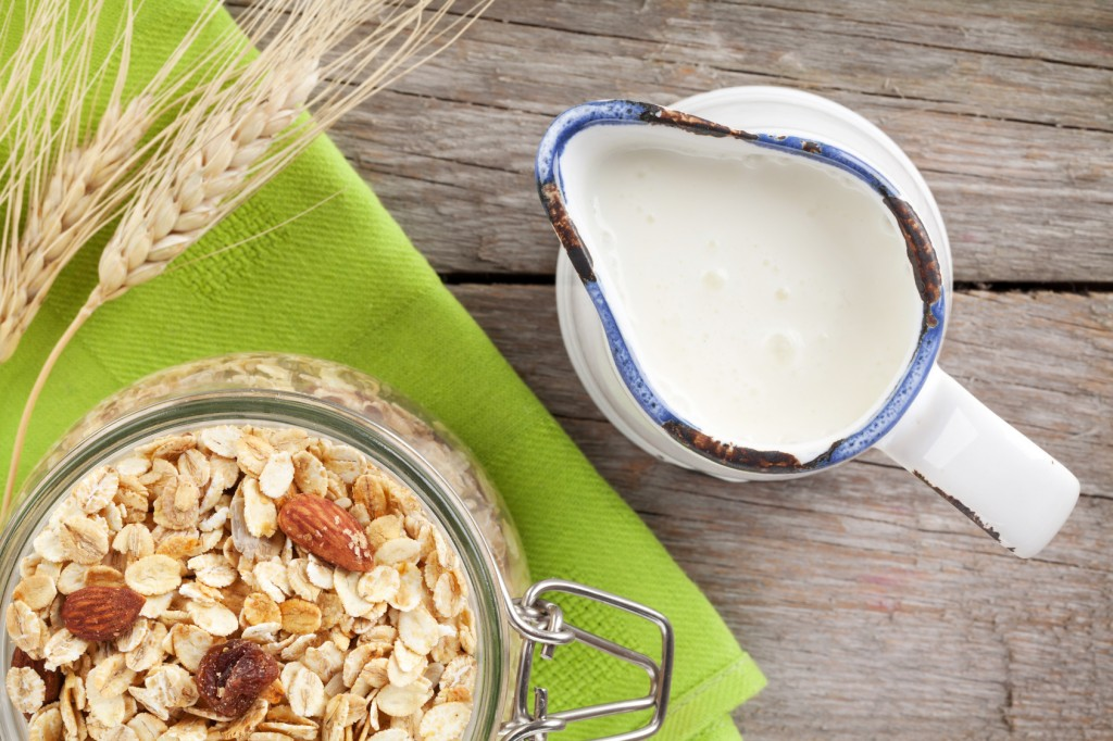 Healthy breakfast with muesli and milk. On wooden table