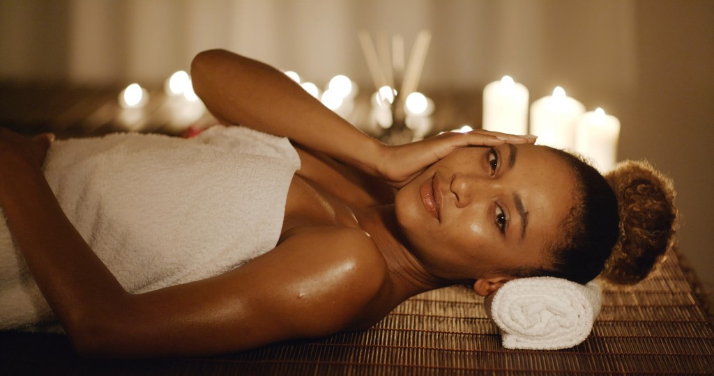 Cute african american woman relaxing in spa slow motion