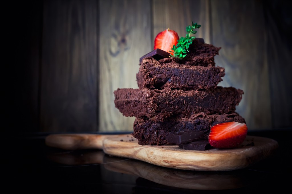 Chocolate cake with strawberry, dark photo