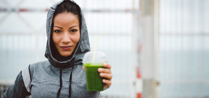 woman-holding-green-smoothie
