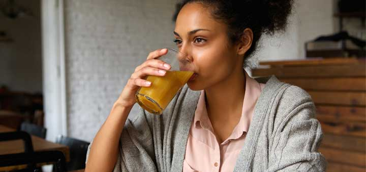black-woman-drinking-juice