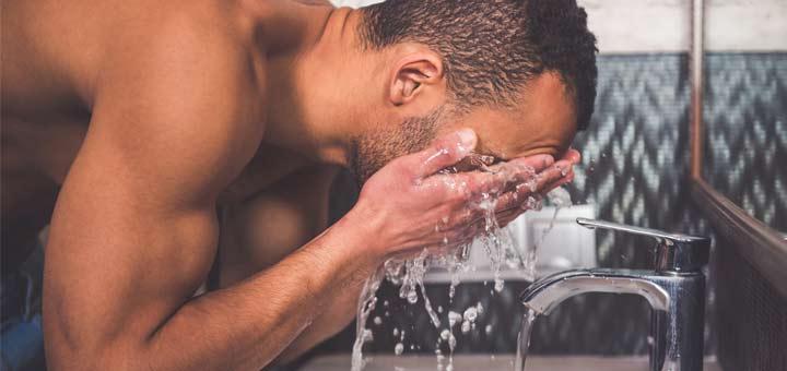 man-washing-face