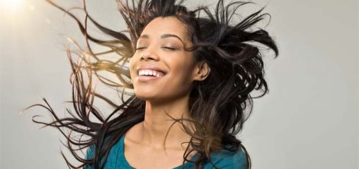 smiling-woman-blowing-hair