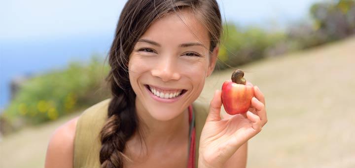 girl-holding-cashew-apple