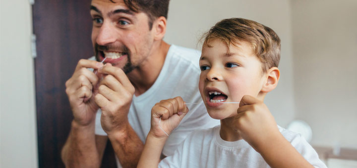 father-and-son-flossing