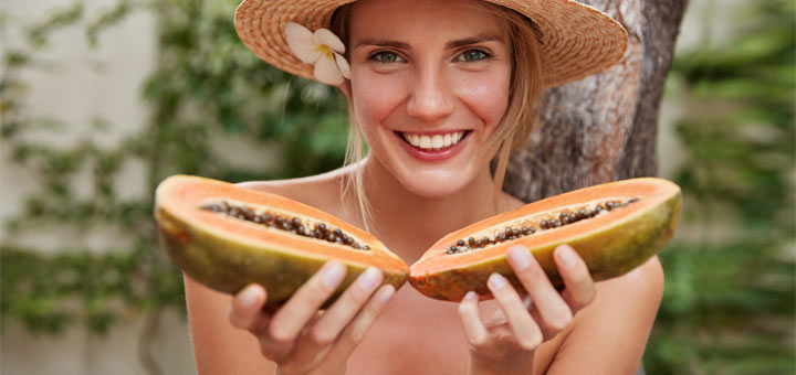 girl-with-papaya-halves