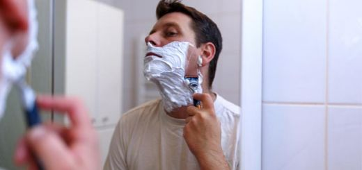 man-shaving-in-mirror