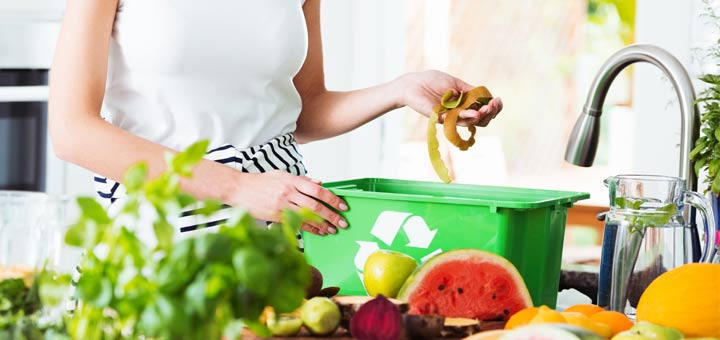 composting-woman-kitchen