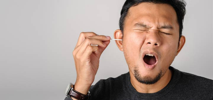 man-cleaning-ear
