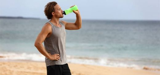 man-drinking-water-beach
