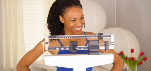 happy-black-woman-on-scale
