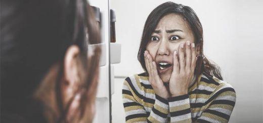 worried-asian-woman-mirror