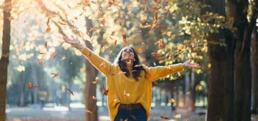 happy-woman-throwing-leaves