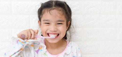 little-asian-girl-brushing-teeth
