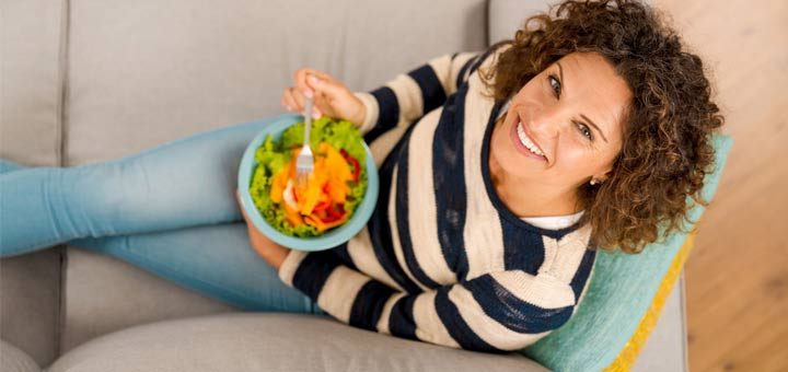 woman-on-couch-salad