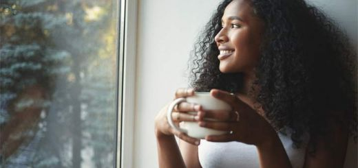 black-woman-drinking-tea-window