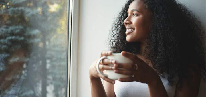 black-woman-drinking-tea-window