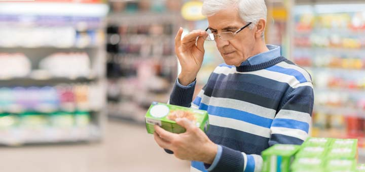 old-man-reading-food-product