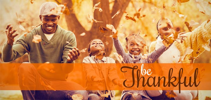 black-family-thankful-throwing-leaves