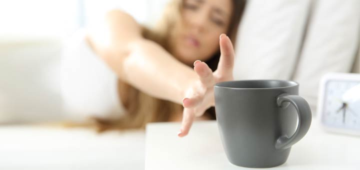 sleepy-woman-reaching-for-coffee