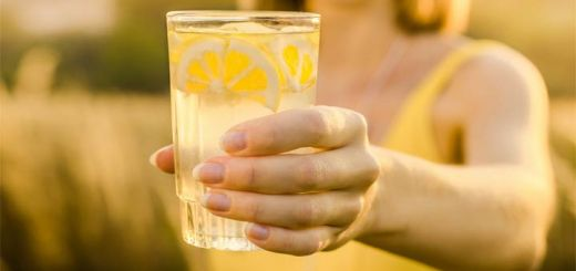 woman-holding-lemon-water