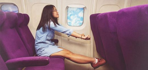 woman-stretching-on-plane