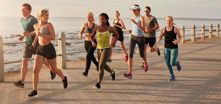 group-of-runners-near-water