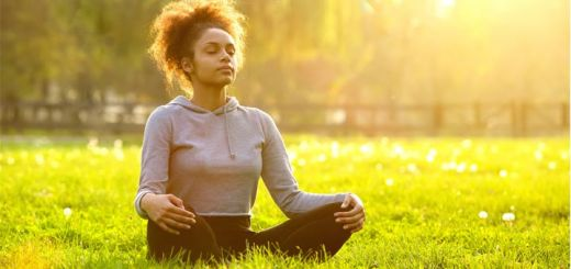 black-woman-meditating-in-field