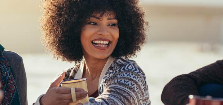 smiling-black-woman-holding-mug