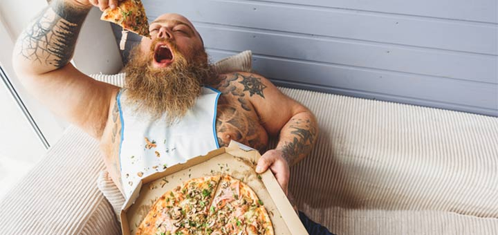 fat-guy-on-couch-eating-pizza