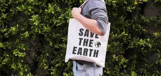man-with-save-the-earth-bag