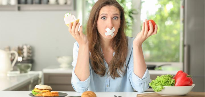 taped-mouth-woman-holding-food