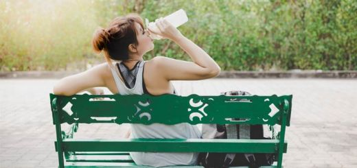 asian-woman-on-bench-hydrating