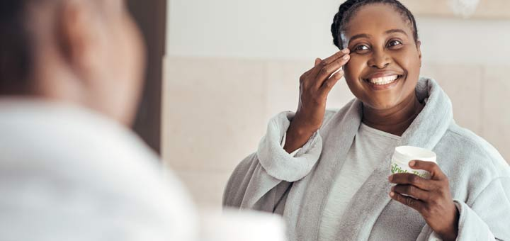 black-woman-moisturizing-face