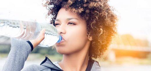 black-woman-drinking-water-bottle