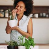 black-woman-smelling-herbs