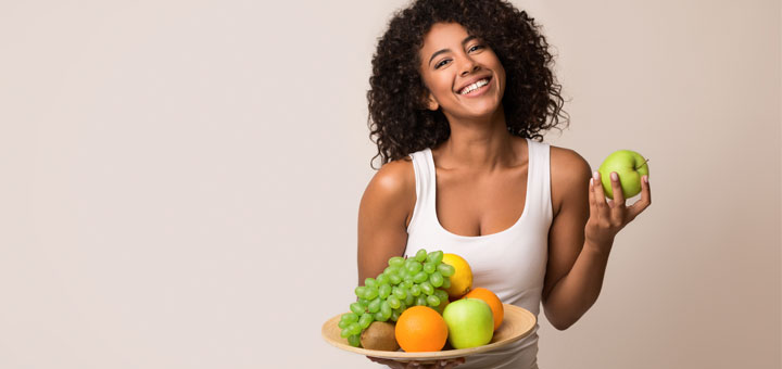 black-woman-holding-fruit-plate