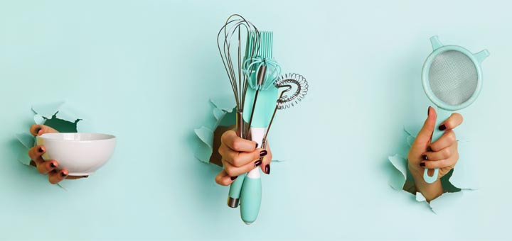 hands-holding-kitchen-tools