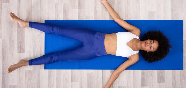 sleeping-black-woman-on-yoga-mat