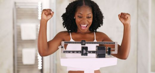 excited-black-woman-on-scale