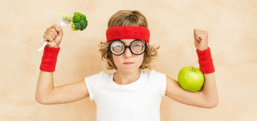 serious-kid-holding-vegetables