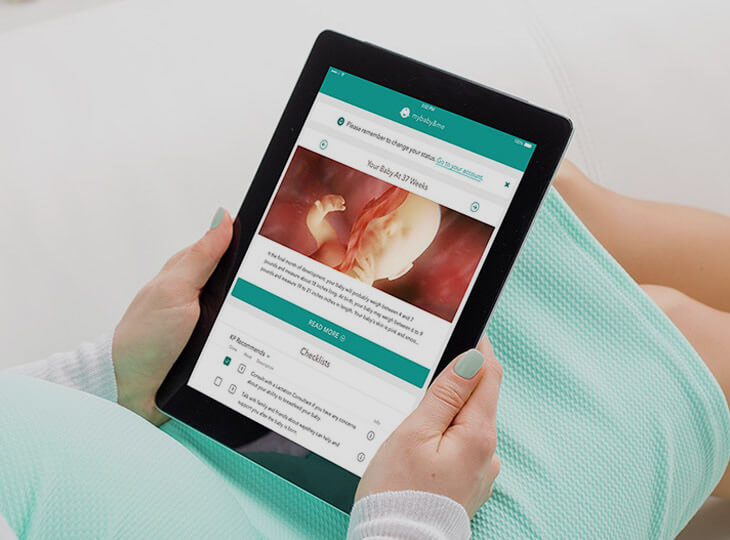 Expecting mother using the Kaiser Permanente App on Tablet