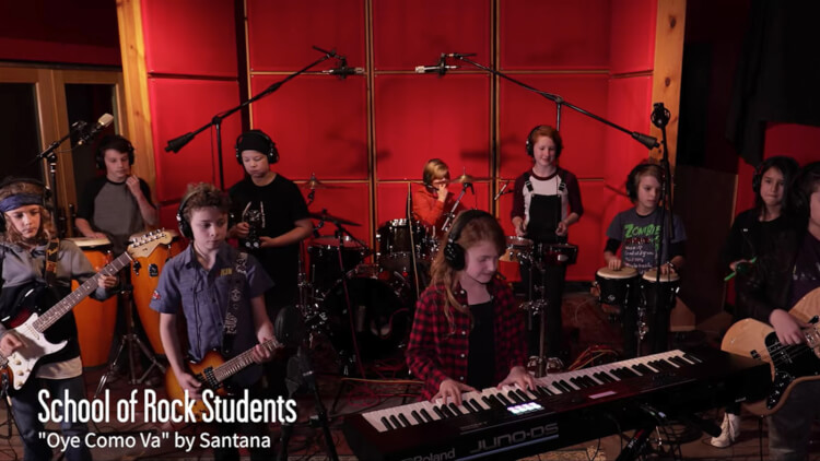 School of Rock students recording Oye Como Va by Santana in the studio