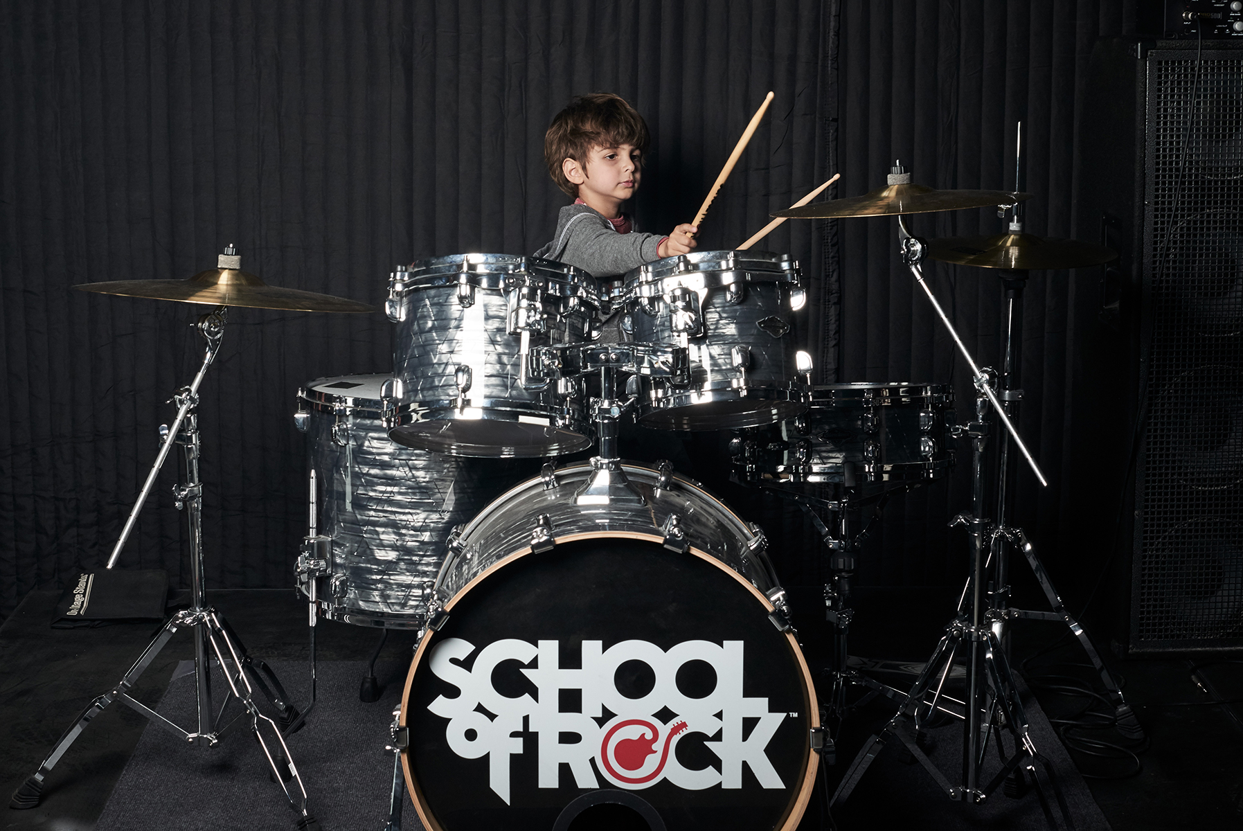 Beginner learning to play the drums