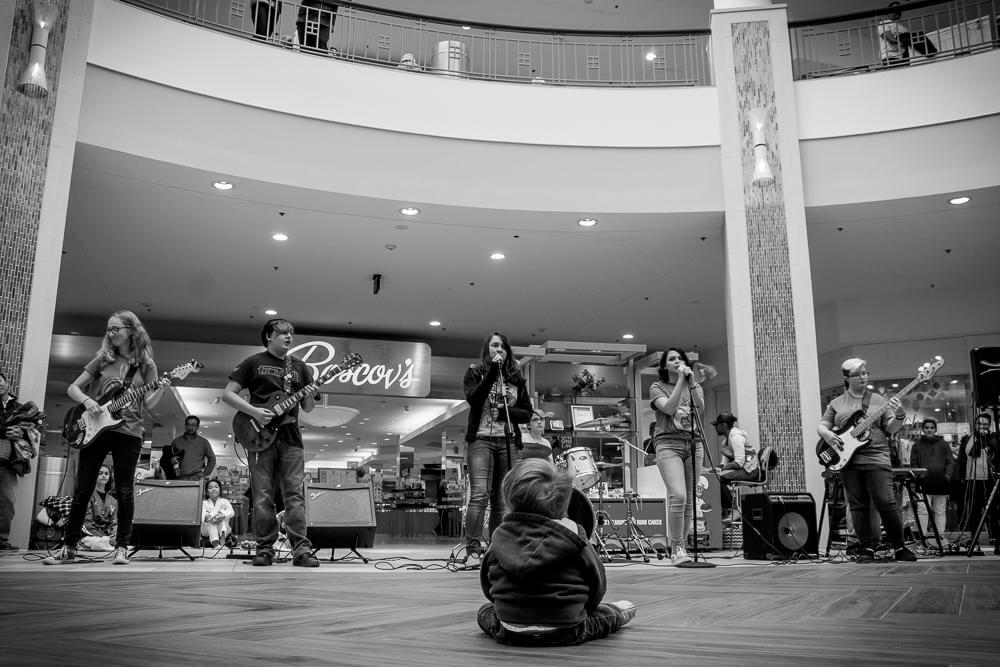 A future rocker sits mesmerized by our House Band during a Blue Star Mother's Troop Drive.