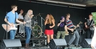 Twin Cities School of Rock Road Crew performs at summer festivals.
