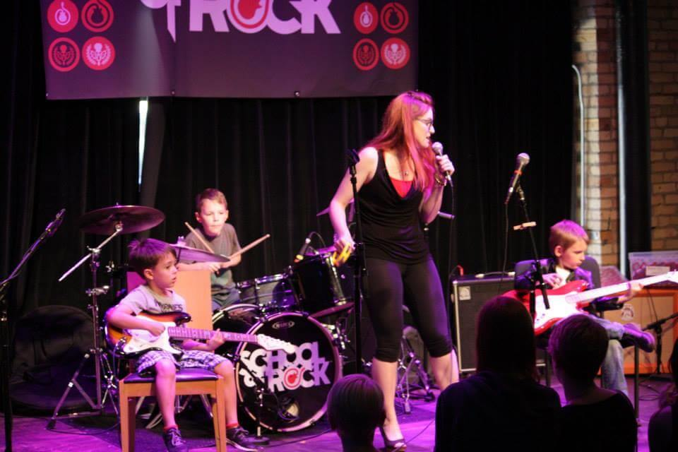 St Paul Rookies perform with their teacher at the School of Rock Mid-Season Show.