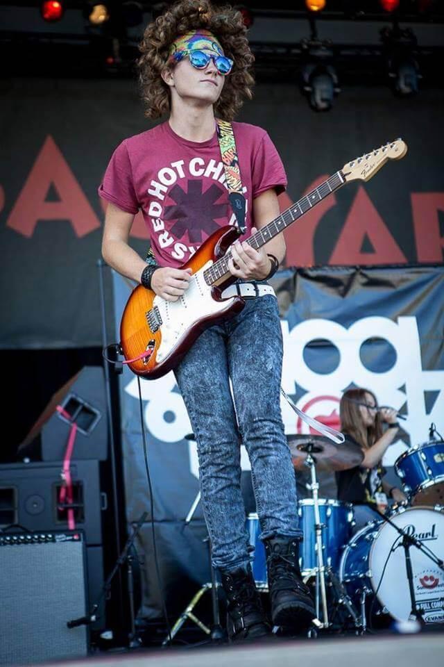 One of our students playing guitar at Summerfest.